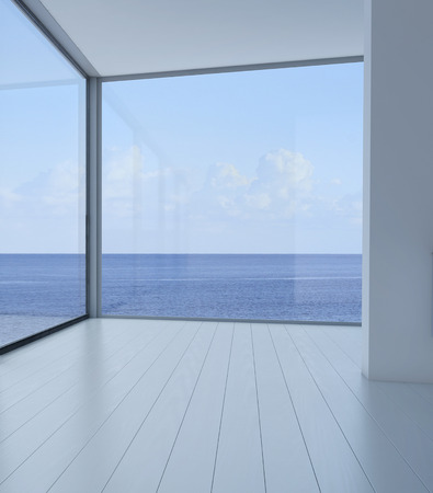 Empty room interior with floor to ceiling windows and scenic view photo