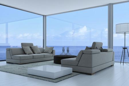 灰色のソファとシースケープ ビューと豪華なリビング ルームのインテリア