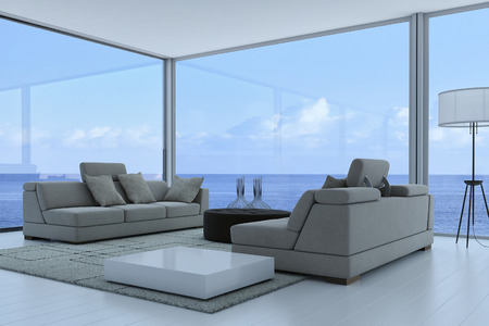 Luxury living room interior with gray couch and seascape view Archivio Fotografico