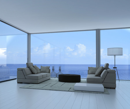 Luxury living room interior with gray couch and seascape view Reklamní fotografie