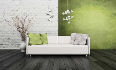 Modern white couch against green wall photo