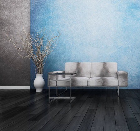 Modern grey couch against blue wall photo