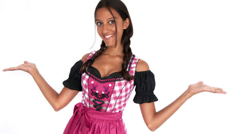 stretched: Happy young woman dressed in dirndl with stretched arms Stock Photo