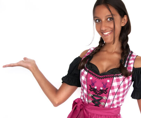 dirndl dress: Happy young woman dressed in dirndl posing