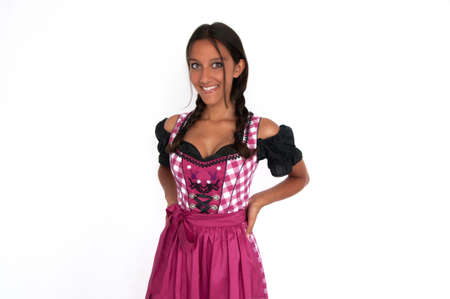 arms akimbo: Happy young woman dressed in dirndl with arms akimbo