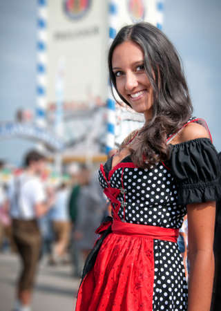Beautiful young woman in dirndl photo