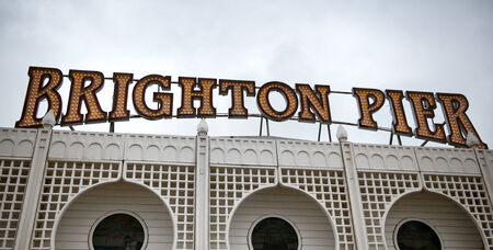 Sign above the entrance to Brighton Pier, also known as Palace Pier, a popular tourist attraction and historical amusement park