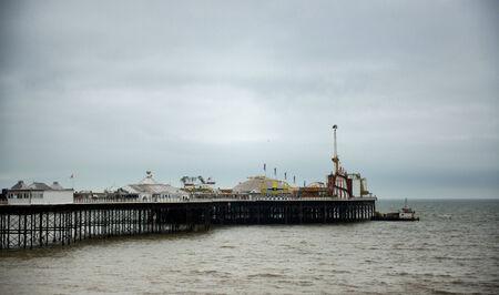 brighton beach: Brighton Pier Under Cloudy Overcast Skies, Brighton, England