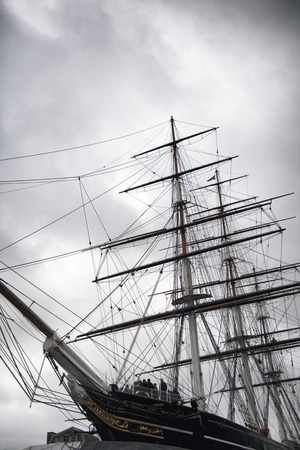 bowsprit: Masts and bowsprit of the Cutty Sark docked in Greenwich London as a museum exhibit of an old three masted Victorian merchant clipper Editorial