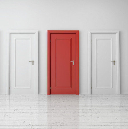 Close up Red Single Door Between Two White Doors on Plain Wall Inside the Building. Stock Photo