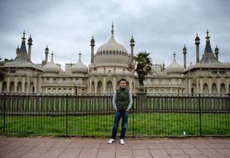 mogul: Man standing in Front of Royal Pavilion in Brighton, England Editorial