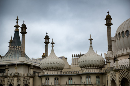 Dome Rooftops of Brighton Royal Pavilion Former Royal Residence Under Cloudy Skies in Brighton, England