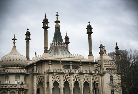 mogul: Dome Rooftops of Brighton Royal Pavilion Former Royal Residence Under Cloudy Skies in Brighton, England Editorial
