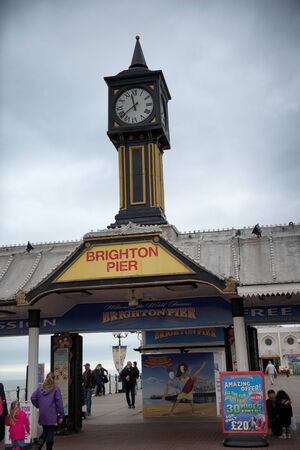 listed buildings: Brighton Pier Clock Tower Under Cloudy Skies in Brighton, England