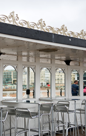 Empty Tables and Chairs Under Covered Awning on Brighton Pier, Brighton, England