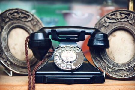 oxidized: Still Life of Old Fashioned Telephone and Metal Plates Display Stock Photo
