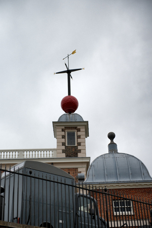 london to brighton: Time Ball on top of Greenwich Royal Observatory Against Cloudy Skies, England