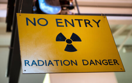 nuclear reactor: Yellow radiation warning and hazard sign forbidding entry to a radioactive zone Stock Photo