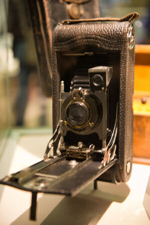 folding camera: Historical Autographic Camera on Display in Museum Editorial