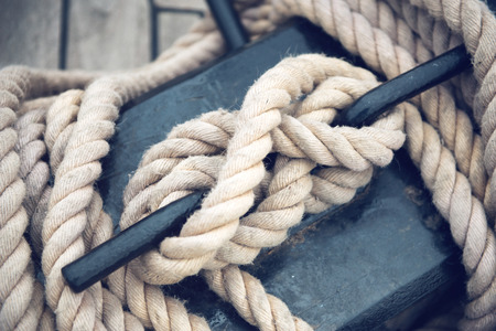 rope knot: Close Up of Boat Rope Tied on Figure Eight Cleat Hitch