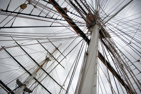 Maritime Naval Rigging of an old merchant clipper, with the spars, mast and pulleys photo