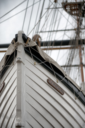 ship bow: Low Angle Detail of Tall Ship Bow or Stern with Mast in Background Editorial