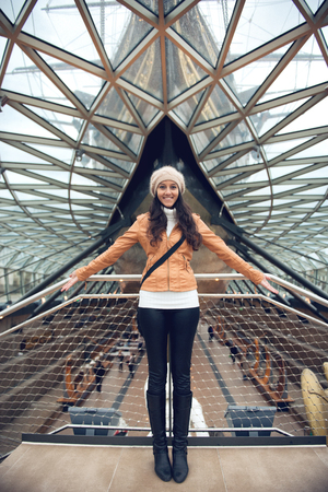 ship deck: Woman with Open Arms in front of Cutty Sark Ship Exhibit at National Maritime Museum, London, England Editorial