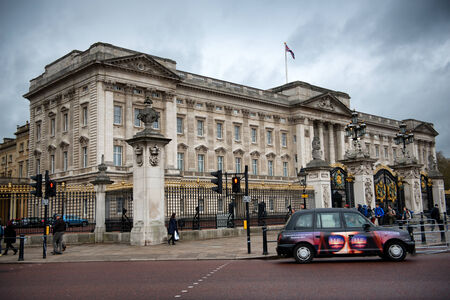 taxi famous building: Car Driving Past Main Gate of Buckingham Palace, London, England