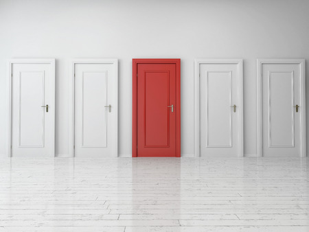 Five Similar Style Single Doors, One is Red and Four are White, on Plain Wall Inside an Empty Building. Archivio Fotografico