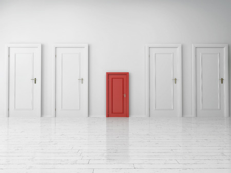 Small Single Red Door Between Large White Doors on White Wall Inside an Empty Architectural House.