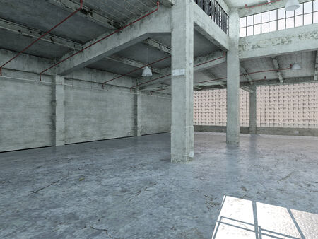 Empty industrial loft in an architectural background with bare cement walls, floors and pillars supporting a mezzanine with windows along one wall Stock Photo