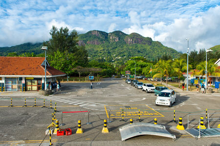 disembarking: Line of taxis waiting at the quayside at Victoria harbour, Mahe, Seychelles to provide transport to passengers disembarking from the tour boats and cruise liners Stock Photo
