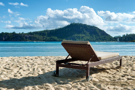 seychelles: Luxury Lounge Chair Facing Water at South Beach at Port Launay, Seychelles