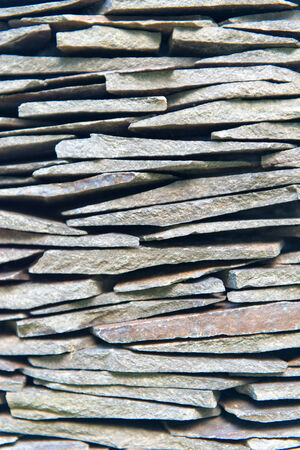 drystone: Close up Vintage Piled Plenty Thin Rocks for Wallpaper Backgrounds Designs