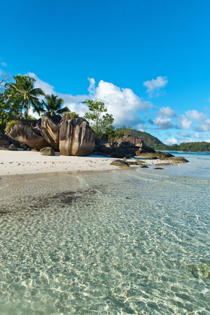 tourist spot: Unusual Rock Formations on Isolated Beach at Anse Lislette, Seychelles Stock Photo