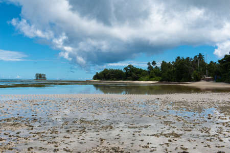 union beach: Stillness of Beautiful Anse Union Beach in La Digue, Seychelles. Captured in Panorama View. Stock Photo