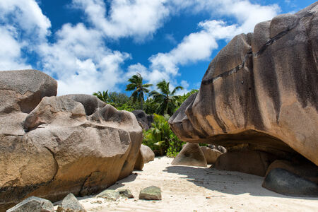 Historic Big Rock Forms at Famous Tropical Paradise in La Digue Island, Seychelles. photo
