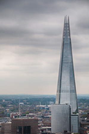 shard of glass: External view of the Shard in London on a cloudy day with copyspace in an architectural and travel concept Stock Photo