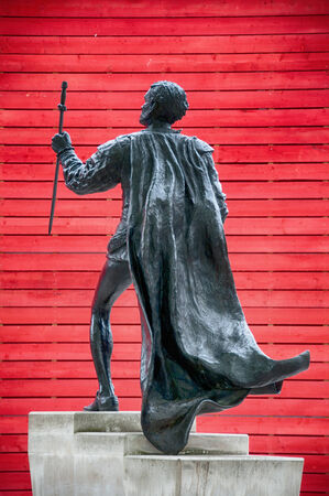 laurence: Famous Vintage Laurence Olivier Statue with Red Wooden Background, at South Bank, London