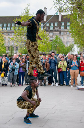 southbank: Jamaican acrobats doing a street performance for a crowd of spectators on the south bank of the River Thames in London