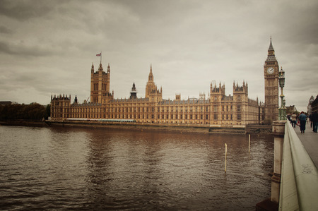 View from a bridge across the River Thames of the iconic Houses of Parliament and Big Ben, London