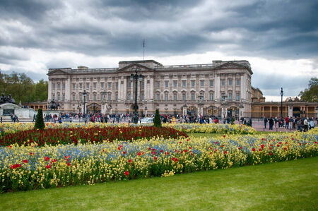 buckingham palace: Tourists at Famous Structure of Buckingham Palace Landmark in London on Stormy Sky Above. Editorial
