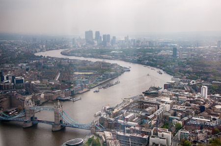 infrastructures: Famous River Thames with Tower Bridge Landmarks in London. Captured in Aerial Panoramic View. Stock Photo