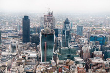 Aerial view of the London CBD and financial district with its modern skyscrapers including the Gherkin in the surrounding cityscape