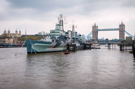 hms: HMS Belfast battleship, now a museum exhibit, moored in the River Thames with the Tower Bridge behind