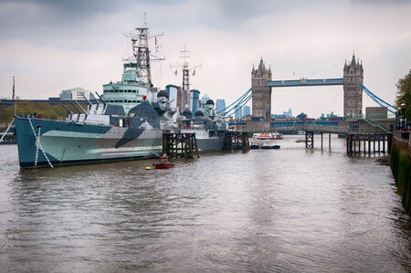 a battleship: Vintage Ship on Famous River Thames with Tower Bridge on the Background, found in London Editorial