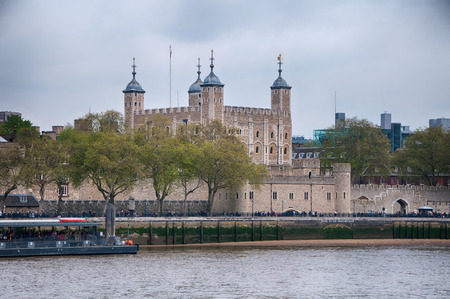 Famous Vintage Architectural Tower of London Building in Front River Thames in London. photo