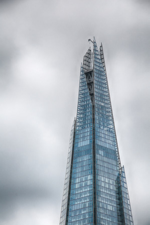 shard of glass: Famous Architectural The Shard of Glass Skyscraper Building in London that Forms Part of the London Bridge Quarter Development Editorial