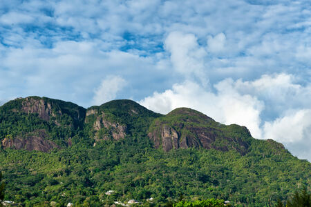 morne: Natural View - Morne Seychellois National Park on a Cloudy Sky Background at Mahe, Seychelles.