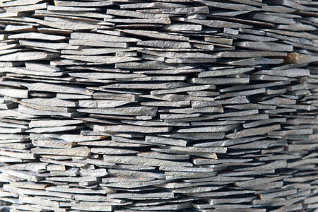 drystone: Stack of stone shingles hewn by hand from slate rock in a drystone wall formation